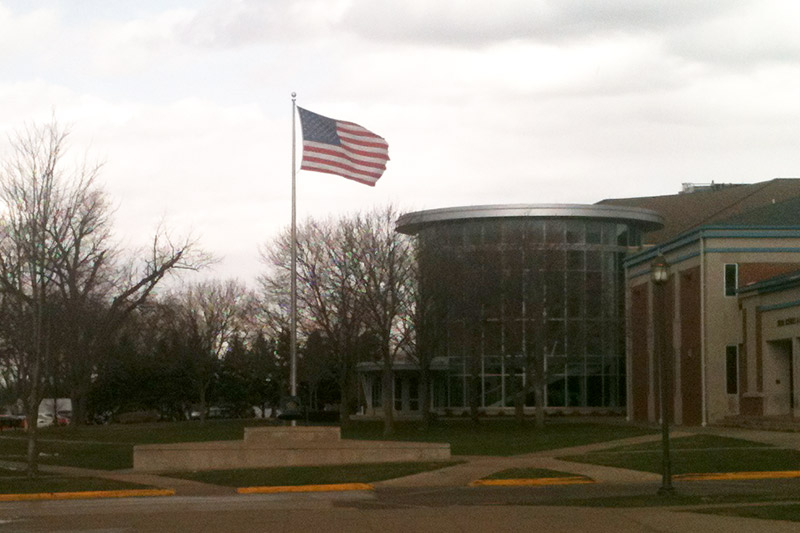 At left, a flag in the city of Storm Lake at half-staff to honor the victims of the Boston bombing. Above, a flag on the BVU campus left a full-staff during the same time period.